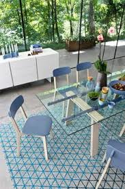 a table bining the tactile nature of wood with the transparency of the gl top that