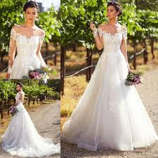 Kitty Chen Designer Discount Kitty Chen 2019 Wedding Dresses Jewel Neck Lace Appliques Illusion Long Sleeve Garden Bridal Gowns Sweep Train Bohemia A Line Wedding Dress