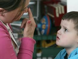 the human voice not spark pleasure in children autism instructional assistant jessica reeder touches her nose to get jacob day 3 who has autism to focus his attention on her during a therapy session in
