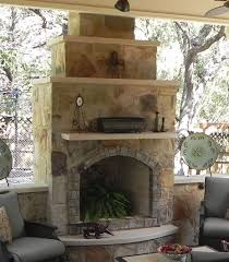 simple outdoor kitchens and patios this austin patio cover features a custom stone outdoor fireplace