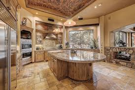 Traditional rustic kitchen with custom island, santa cecelia granite and  tuscany chateaux travertine floor tile