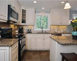 white cabinets with black appliances kitchen colors with white