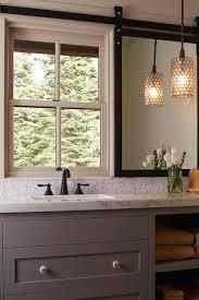 currey and company pendant lights regatta country bathroom artistic gray orange accents vanity mirror on rail