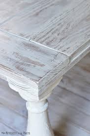 distressed coffee table painted with mms milk paint in grain sack and distressed with a wet