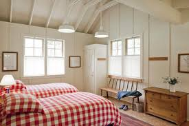 white country bedroom with red gingham on twin beds