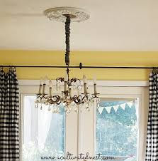 a cultivated nest glam up your light fixture with a ceiling medallion this one