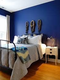 Antique Metal Bed And Navy Blue Wall Color For Amazing Bedroom Decorating  Ideas Using Classic White Side Table
