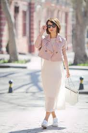 picture of a white airy dress a pink cropped leather jacket white sneakers and a white bag