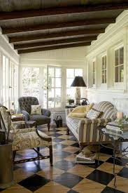 cozy sun porch painted floors dark stained or painted ceiling deborah leamann interiors