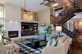Large trendy formal and open concept medium tone wood floor and brown floor  living room photo