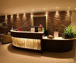 highlight lighting. wall washers can be used to highlight a textured as shown on the stone behind reception desk note how front of is backlit for visual lighting