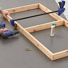 fasten rails between the game board sides