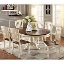 add brightness to your kitchen or dining area with the bethannie oval dining table featuring an eye catching two tone design this charming table is sure