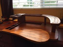 as you can see this is no ordinary rectangular manufactured tying station this masterpiece is made of walnut and the teardrop inlay is made of ambrosia