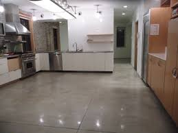stunning grey polished and poured concrete floor using white cabinet with metal hood for adorable large modern kitchen ideas