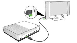 xbox one s setup setting up xbox one s hdmi cable being plugged into the hdmi out port on the xbox one s console and