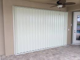 large accordion shutter for sliding glass doors