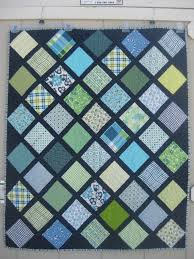 Baby boy lattice quilt using DS Quilts fabric and navy sashing ... & Charm Squares on Point quilt Adamdwight.com