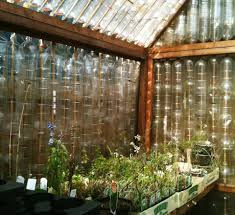 a very green greenhouse made from recycled drinks bottles