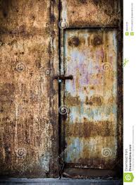 rusty old brown metal door