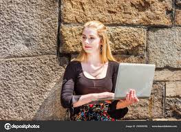 Young American Teenage College Student Studying New York Wearing
