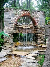 garden waterfall imitating an old building s wall