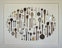 Grouping like objects in a shadow box is a nice way to display collections  without having your space feel too cluttered.