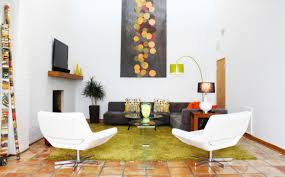 mid century modern living room black velvet sectional sofa multicolored accent pillows modern white lounge chairs