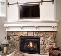 mini barn door sliding doors over fireplace classy way to cover tv mini hanger in green patina could you hang a plasma over a wood stove