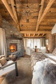 log cabin bedroom bedroom rustic with bedding chandelier fireplace mantels image by lohss construction