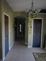 attractive interior room design with green wall paint color also black indoor doors
