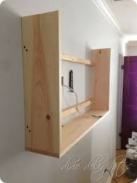 create a cabinet around tv and hang a picture on a hinge to cover it.