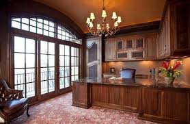 a traditional chandelier is the perfect finishing touch for a formal victorian style home office
