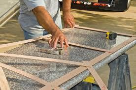 contractor fixing granite slab