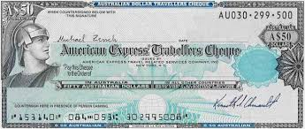 traveller check should i exchange money before i travel