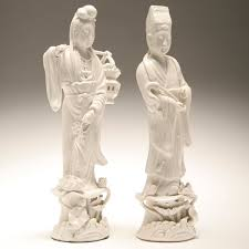 White porcelain asian figurines
