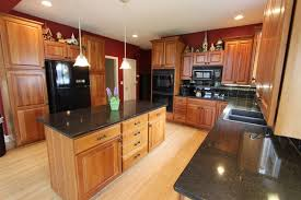 black quartz countertop with black subway tile backsplash cuyahoga falls oh traditional kitchen