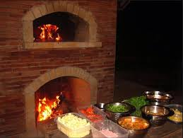 outdoor fireplace and oven combination