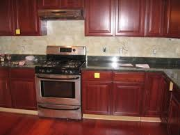 kitchen brown varnished cherry wood kitchen cabinet on laminate flooring plus black countertop and grey