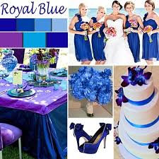 Use purple centerpieces of a variety of shades to enhance the beauty of  your royal blue tables.