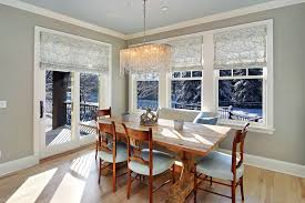 roman shades for sliding glass doors dining room eclectic with blue pillow casual dining