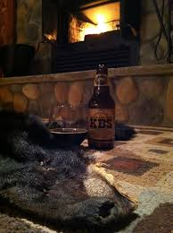 have dinner on a bearskin rug in a cabin in front of a roaring fireplace