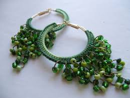 a cascade of jump rings and beads make this hoop pair more like chandelier earrings