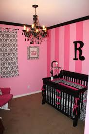 Hot pink stripes & black damask create a chic nursery
