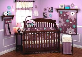 nursery themes for girls purple flowery pattern on blanket baby girl nursery theme with unique wooden