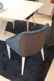 another style of dining chair from mobilario is upholstered in two diffe fabrics the front