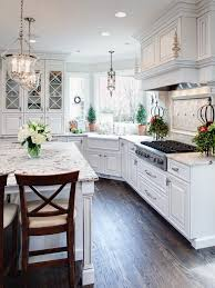 50 Beautiful Kitchen Design Ideas for You Own Kitchen. Corner sink, windows  around sink, island with overhang on all sides, backsplash behind stovetop.