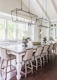 lantern style pendant lighting. french style dining area in kitchen with linen covered wooden bar stools and lantern rectangular pendant lighting
