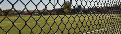 wire fence gate. Black Color Chain Link Fences Are Installed In The Stadium. Wire Fence Gate
