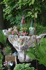 Favorite fairy garden container, originally sold as a table base, but makes  a way